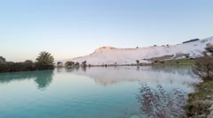 Sunrise in Pamukkale (Turkey) with the white hill and its reflection in the Stock Footage