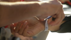 Armband being attached Stock Footage