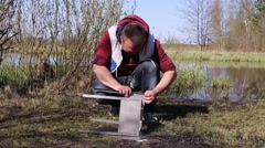 Man Making Brazier for Barbecue - stock footage