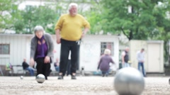 Old Couple Playing Petanque Stock Footage