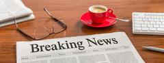 A newspaper on a wooden desk - Breaking News Stock Photos