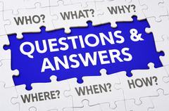 Text on puzzle pieces - Questions and answers Stock Photos