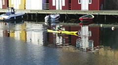 Kayaking in fishing hamlet Smogen on the Swedish west coast (district Bohuslan). - stock footage