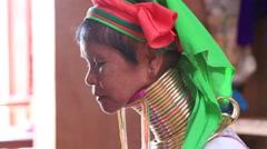 Padaung Tribal woman poses for a photo in Inle lake, Myanmar, Burma - stock footage
