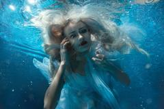 Portrait of a woman under water. Stock Photos