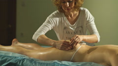 the woman doing the massage of the buttocks - stock footage