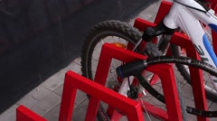 Man Hands Unlocked Bicycle Lock on Parking Stock Footage