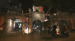 Street scene in front of a old city gate in Hanoi, Vietnam. Stock Footage
