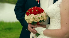 The bride holds the wedding bouquet Stock Footage