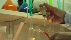 Multicolored liquids and substances in chemistry lab, ULTRA HD 4K, real time Stock Footage