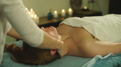 A woman doing a shoulder massage Stock Footage