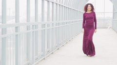 Beautiful curly-haired woman in a long dres - stock footage