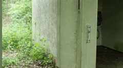 Two FBI Agents searching an abandoned building in a forest – Shot7 of 10 Stock Footage