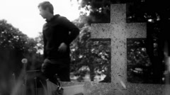 Cemetery Scene of Man crying At Tombstone Before Leaving - stock footage