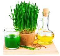 Wheatgrass juice with sprouted wheat and wheat germ oil on the mat Stock Photos