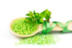 Wooden spoon with green bath salt Stock Photos