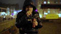 Man Drinking Beer With Chips On Street Stock Footage