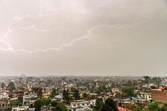 Lightning bolt over Patan and Kathmandu Stock Photos
