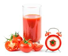 Concept with tomato juice, red clock and tomato - stock photo