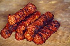 """Traditional food Meat Balls """"mici"""" on a rustic wooden table with mustard - stock photo"""