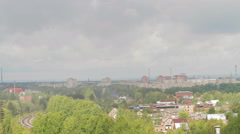 Aerial view of city, trees and railway - stock footage