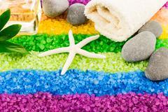 Sea salt with shell, stones, aroma oil and bath towel - stock photo