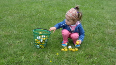 Children on a golf field - little girl play walk with balls put in buckets - stock footage