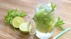 Summer drink with fresh lime and mint Stock Footage