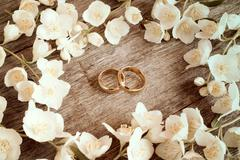 Wedding rings in a middle of flowers Stock Photos