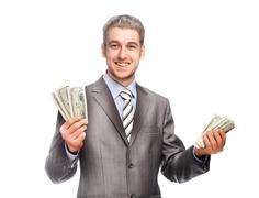 Lucky grey-haired man with money - stock photo