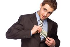Lucky man putting money in his bosom - stock photo