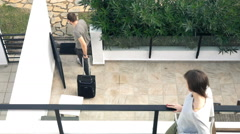 Couple break up, man going away with suitcase, super slow motion Stock Footage