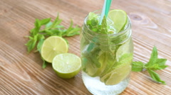 Refreshing mojito with sparkling water - stock footage