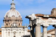 Roman Forum with Temple of Saturn, and the dome of Santi Luca e Martina behind, Stock Photos