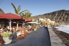 Restaurants at the promenade of Playa del Puerto Beach, Puerto de Tazacorte, La - stock photo