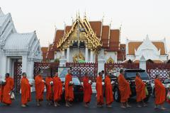 Monks collecting morning alms, The Marble Temple (Wat Benchamabophit), Bangkok, Stock Photos