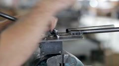 Sharpening the metal detail on the grinding machine - stock footage