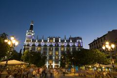 People relaxing in in the evening in Plaza de Santa Ana in Madrid, Spain, Europe - stock photo