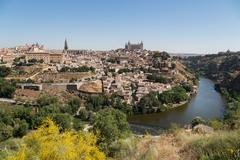 The River Tagus with the Alcazar and cathedral towering above the rooftops of Stock Photos