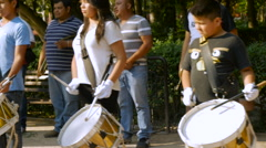 Young band members practice their drums in Benito Juarez park Stock Footage
