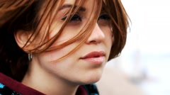 Waving in the wind the hair of a beautiful girl Stock Footage