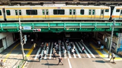 Tokyo - Nakano station time lapse of people, trains and traffic. 4K Stock Footage
