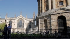 Students talking by Radcliffe Camera Oxford Stock Footage