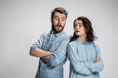 The young couple with different emotions during conflict Stock Photos