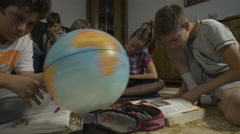 Elementary school kids learning at home by Sheyno, crane shot. Stock Footage
