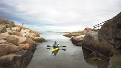 Kayaking in Sweden near the old fishing hamlet Smogen on the Swedish west coast Stock Footage