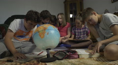 Boys and girls learning together at home by Sheyno, tracking shot. Stock Footage