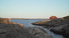 Red cottage and lifebuoy on the Swedish west coast (district Bohuslan). Stock Footage