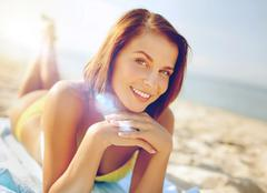 girl sunbathing on the beach - stock photo