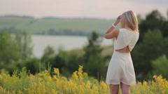 Beautiful young blond woman enjoying the fabulous nature Stock Footage